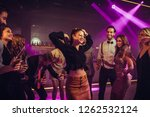 shot of a young woman partying... | Shutterstock . vector #1262532124