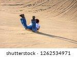 tourists ride the sandboards... | Shutterstock . vector #1262534971