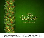 holiday decorations on green... | Shutterstock .eps vector #1262540911