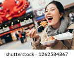 cheerful lady tourist trying... | Shutterstock . vector #1262584867