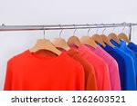fashionable clothing on hangers ...   Shutterstock . vector #1262603521