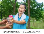 asian woman relax time in park. ...   Shutterstock . vector #1262680744