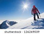 Mountaineer Reaches Top A Snowy - Fine Art prints