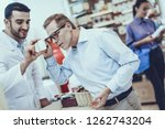 pharmacist showing bottle with...   Shutterstock . vector #1262743204