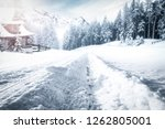 winter road to the snow... | Shutterstock . vector #1262805001