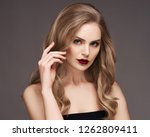 blonde woman with curly... | Shutterstock . vector #1262809411