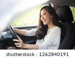 asian women driving a car and... | Shutterstock . vector #1262840191