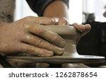 hands of potter at work.... | Shutterstock . vector #1262878654