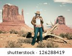 blond cowgirl holding wanted... | Shutterstock . vector #126288419