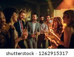 Stock photo shot of young people partying in a nightclub 1262915317