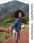 beautiful african woman smiling ... | Shutterstock . vector #1262964451