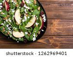 autumn spinach salad with apple ... | Shutterstock . vector #1262969401
