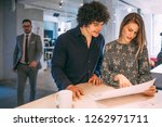 couple looking at a project of...   Shutterstock . vector #1262971711