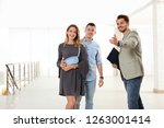 real estate agent showing new... | Shutterstock . vector #1263001414