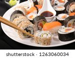 selection of sushi and maki | Shutterstock . vector #1263060034