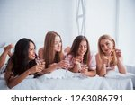 holding glasses with alcohol.... | Shutterstock . vector #1263086791