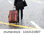 slim girl with a suitcase on...   Shutterstock . vector #1263121807
