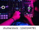 dj in the booth playing in a... | Shutterstock . vector #1263144781