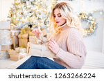 a woman in a christmas interior ... | Shutterstock . vector #1263266224
