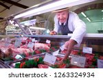 Butcher In Apron And Hat...