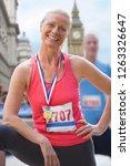 mature female marathon runner... | Shutterstock . vector #1263326647