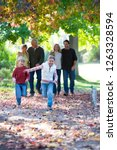 multi generation family walking ... | Shutterstock . vector #1263328594