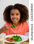 portrait of girl at table... | Shutterstock . vector #1263338404
