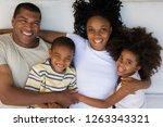 portrait of smiling family... | Shutterstock . vector #1263343321
