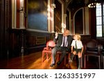grandfather showing grandson... | Shutterstock . vector #1263351997