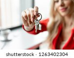 mortgage concept. woman in red... | Shutterstock . vector #1263402304