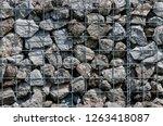 stone gabion wall | Shutterstock . vector #1263418087