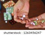 elderly asian man holding many... | Shutterstock . vector #1263456247