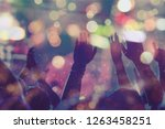 audience with hands raised at a ... | Shutterstock . vector #1263458251