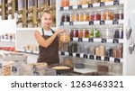 young woman is offering dried... | Shutterstock . vector #1263463321
