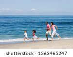 active family running along... | Shutterstock . vector #1263465247