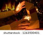 woman's hands opening christmas ... | Shutterstock . vector #1263500401