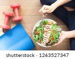 top view healthy girl eating... | Shutterstock . vector #1263527347