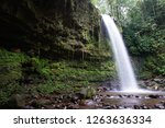 mahua waterfall is a plunge... | Shutterstock . vector #1263636334