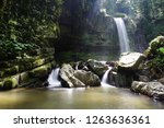 mahua waterfall is a plunge... | Shutterstock . vector #1263636361