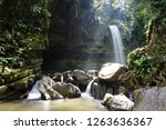 mahua waterfall is a plunge... | Shutterstock . vector #1263636367