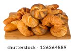 fresh breakfast buns on bamboo board - stock photo