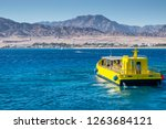 kitesurfing and glass boat in... | Shutterstock . vector #1263684121