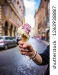 italian ice cream in woman's... | Shutterstock . vector #1263938887