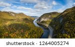 Aerial panoramic view of a scenic road during a vibrant sunny day. Taken near Corner Brook, Newfoundland, Canada.