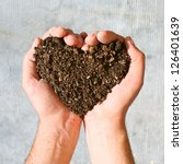 hands holding an earth heart | Shutterstock . vector #126401639