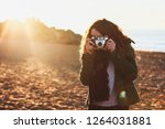 girl with curly hair taking... | Shutterstock . vector #1264031881