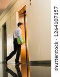 businessman entering office... | Shutterstock . vector #1264107157
