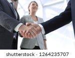 friendly handshake of business... | Shutterstock . vector #1264235707
