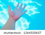 hand is in the pool | Shutterstock . vector #1264320637