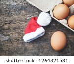 eggs in a box with christmas hat | Shutterstock . vector #1264321531